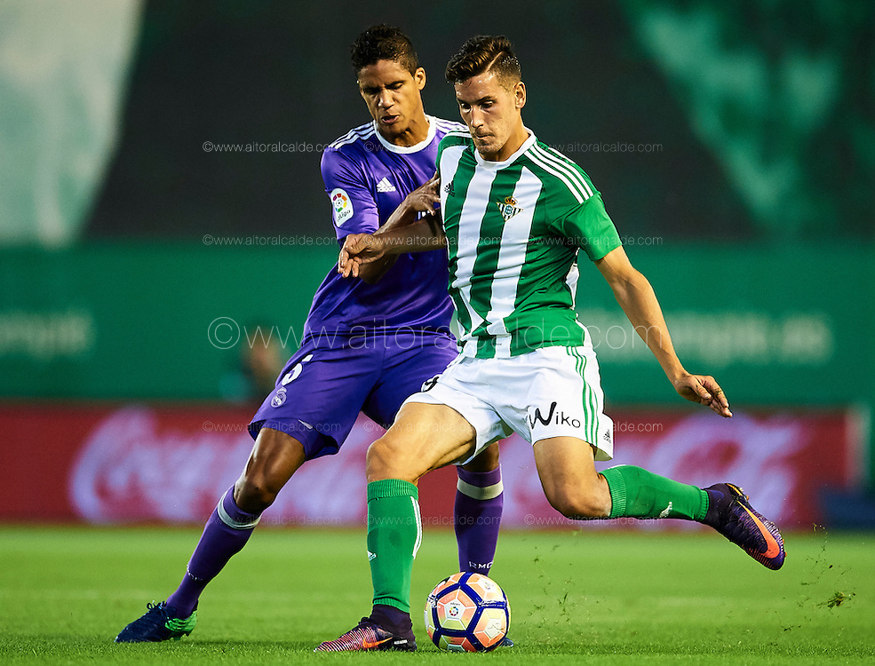 SEVILLE, SPAIN - OCTOBER 15:  Alex Alegria of Real Betis Balompie (R) being followed by Raphael Varane of Real Madrid CF (R) during the match between Real Betis Balompie and Real Madrid CF as part of La Liga at Benito Villamrin stadium October 15, 2016 in Seville, Spain.  (Photo by Aitor Alcalde/Getty Images)