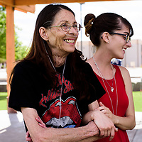 "Cheryl Tracy (left) waits with her daughter Cassandra Ballew before the live music begins at the 7 Trails of Gold Outdoor Festival in Grants, New Mexico on Saturday, June 3, 2017. The event offered li ve music, which enticed Tracy to come with her family. ""I came here for the rock and roll,"" Tracy said."