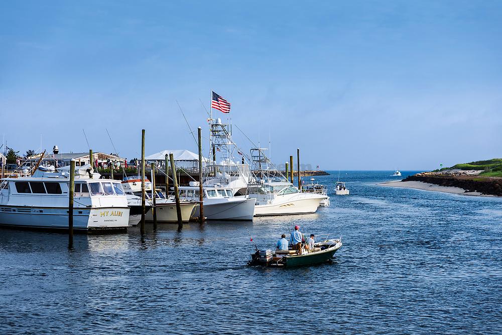 Charter fishing boats leaving Sesuit Harbor, Dennis, Massachusetts, USA.