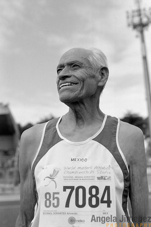 "87-year-old senior athlete Armando Estanol (tilde on the ""n"") of Cuernavaca, Mexico is photographed participating in the 85-89 age bracket long jump event during the 2007 World Masters Championships Stadia (track and field competition) at Riccione Stadium in Riccione, Italy on September 6, 2007. ..9,000 male and female athletes over the age of 35 from 90 countries competed in two weeks of track and field events at the 17th annual event. The event is run by  the World Association of Masters Athletes, the organization designated by the IAAF (The International Association of Athletics Federations) to conduct the worldwide sport of masters athletics. The organization runs competitions and maintains record standings in the 5-year increment age divisions.  ..."