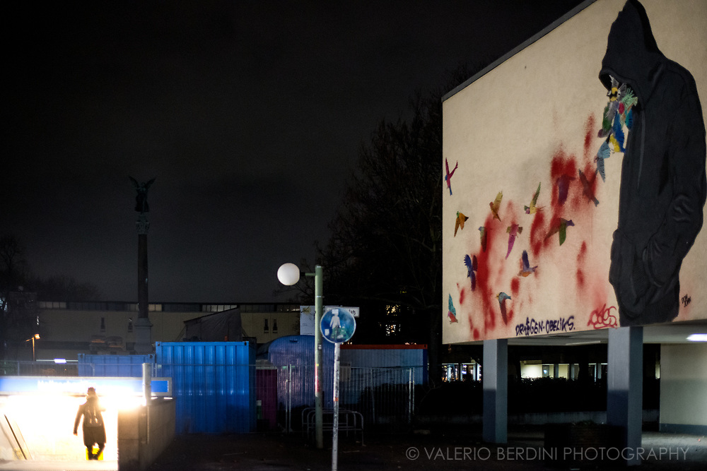A graffiti on a building in Berlin next to the entrance of a Metro Station
