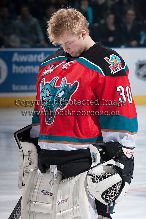 KELOWNA, CANADA - DECEMBER 6: Jordon Cooke #30 of the Kelowna Rockets lines up against the Everett Silvertips on December 6, 2013 at Prospera Place in Kelowna, British Columbia, Canada.   (Photo by Marissa Baecker/Shoot the Breeze)  ***  Local Caption  ***   Jordon Cooke;