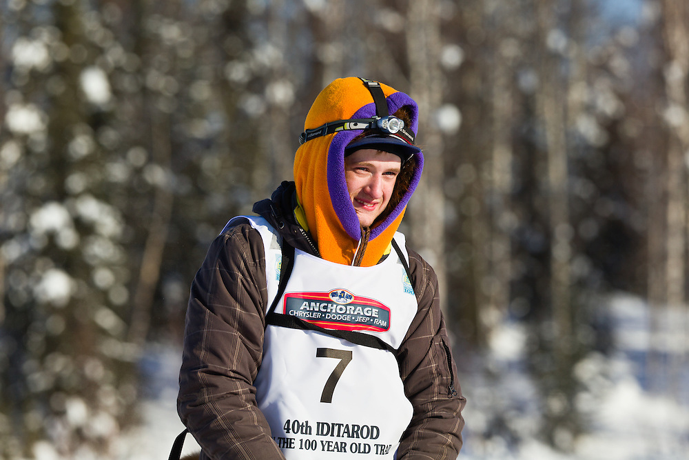 Musher Wade Marrs competing in the 40th Iditarod Trail Sled Dog Race on Long Lake after leaving the Willow Lake area at the restart in Southcentral Alaska. Afternoon. Winter.