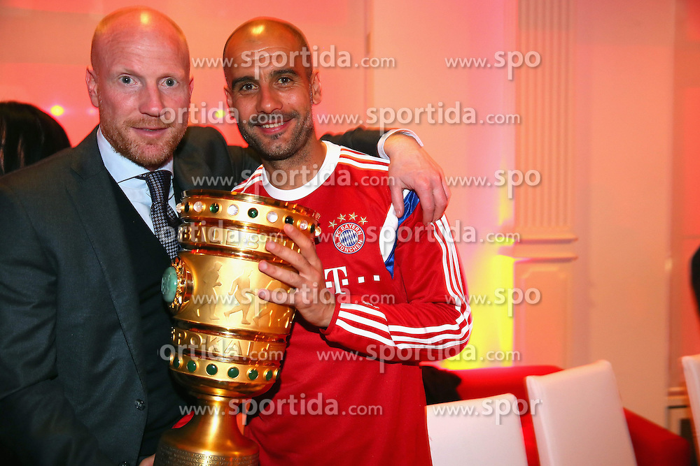 17.05.2014, T Com, Berlin, GER, DFB Pokal, Bayern Muenchen Pokalfeier, im Bild Josep Guardiola (R), head coach of Bayern Muenchen holds the German DFB Cup Trophy with his sporting director Matthias Sammer Josep Guardiola, Matthias Sammer, // during the FC Bayern Munich &quot;DFB Pokal&quot; Championsparty at the T Com in Berlin, Germany on 2014/05/17. EXPA Pictures &copy; 2014, PhotoCredit: EXPA/ Eibner-Pressefoto/ EIBNER<br /> <br /> *****ATTENTION - OUT of GER*****
