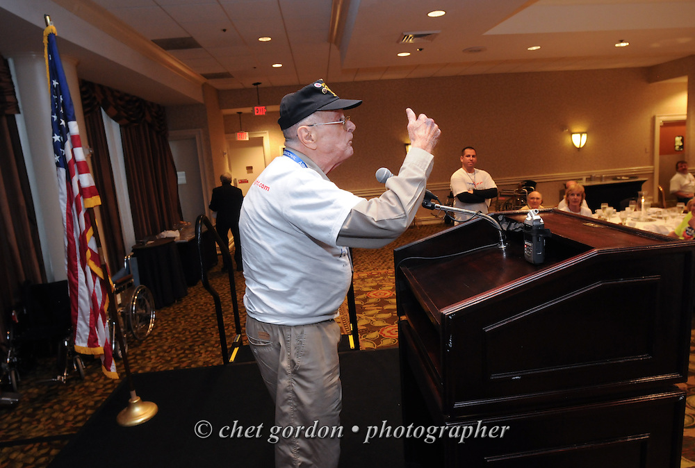 ARLINGTON, VA.  WWII Veterans and their escorts onboard the Hudson Valley Honor Flight during dinner at the Doubletree Hotel in Arlington, VA on Saturday, September 21, 2013.  © www.chetgordon.com