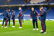 Arsenal players inspect the pitch ahead of the Premier League match between Chelsea and Arsenal at Stamford Bridge, London, England on 21 January 2020.