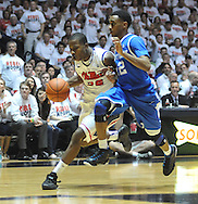"""Mississippi's Jarvis Summers (32) drives against Kentucky's Ryan Harrow (12) at the C.M. """"Tad"""" Smith Coliseum on Tuesday, January 29, 2013. Kentucky won 87-74. (AP Photo/Oxford Eagle, Bruce Newman).."""