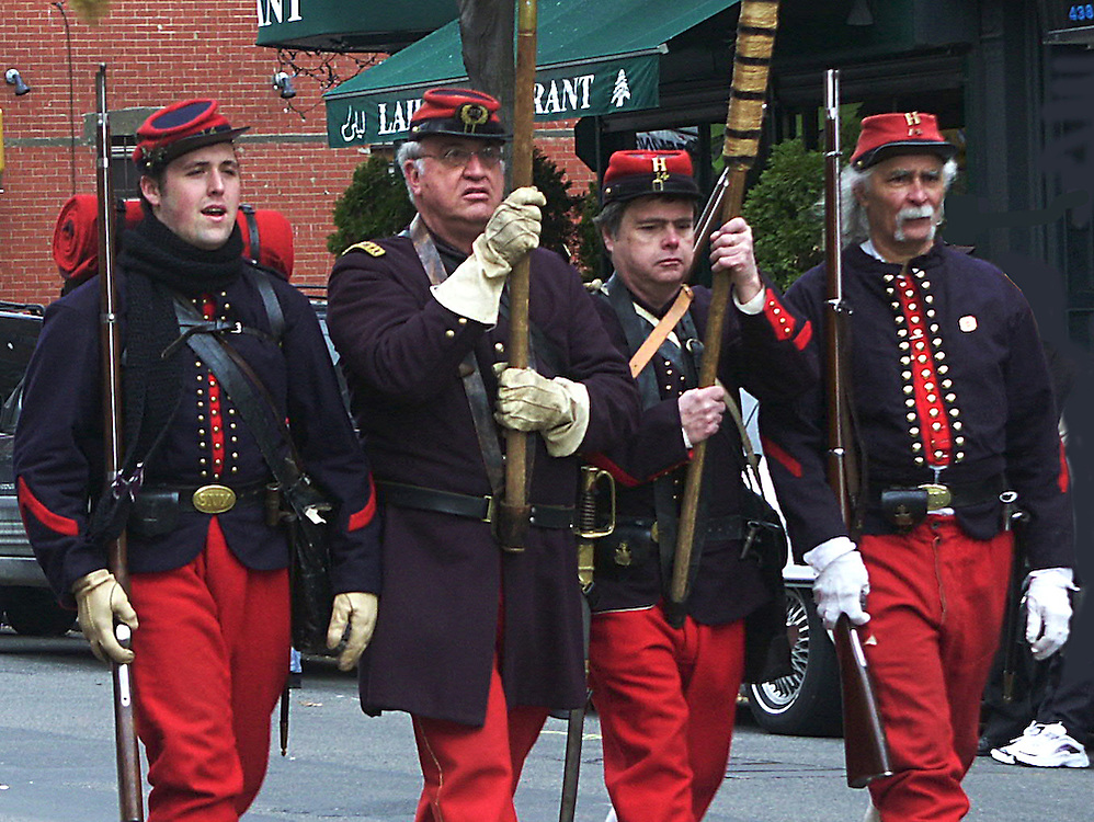 In Civil War Union soldier dress, four guys at Brooklyn's local Saint Patrick's Day Parade.