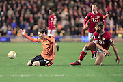 Nathan Baker fouls Joe Mason during the Sky Bet Championship match between Wolverhampton Wanderers and Bristol City at Molineux, Wolverhampton, England on 8 March 2016. Photo by Daniel Youngs.