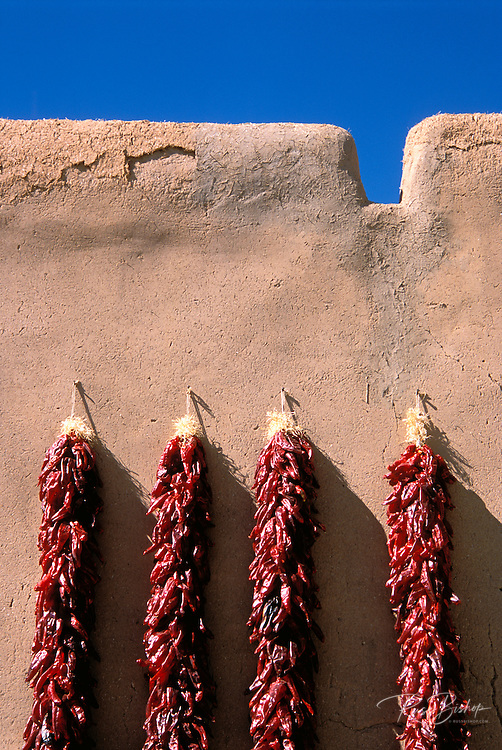 Large chili rostras on adobe wall at the entrance to the Martinez Hacienda (circa 1804), Taos, New Mexico