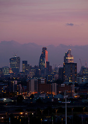 © Licensed to London News Pictures. 19/06/2014. London, UK. A sunset view of the City from Stratford, east London, the last day before the Summer solstice. Photo credit : Isabel Infantes / LNP