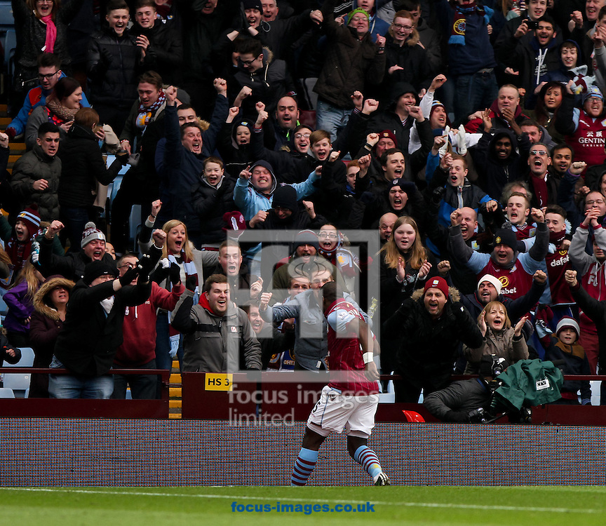 Jores Okore of Aston Villa celebrates scoring his sides first goal in front of his fans during the Barclays Premier League match at Villa Park, Birmingham<br /> Picture by Tom Smith/Focus Images Ltd 07545141164<br /> 07/02/2015