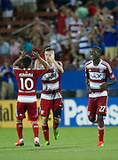 FRISCO, TX - JUNE 22:  Walker Zimmerman #25 of FC Dallas celebrates with teammates David Ferreira #10 and Je-Vaughn Watson #27 after scoring the game tying goal against Sporting Kansas City on June 22, 2013 at FC Dallas Stadium in Frisco, Texas.  (Photo by Cooper Neill/Getty Images) *** Local Caption *** Walker Zimmerman