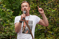 London, UK. 6 July, 2019. Ray Woolford, who runs the largest non-corporate foodbank in the UK, addresses activists from Lesbians and Gays Support The Migrants, African Rainbow Family, the Outside Project, Micro Rainbow and other LGBT+ groups preparing to take part in a London Pride Solidarity March in solidarity with those for whom Pride in London is inaccessible and in protest against the corporatisation of Pride in London.