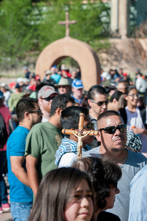 em041417f/a/Tony Martinez, from Ranchitos, wait in a long line to get into the Santuario de Chimayo, Friday April 14, 2017. With beautiful weather, thousands of people were making the Good Friday pilgrimage to the Northern New Mexico church.  (Eddie Moore/Albuquerque Journal