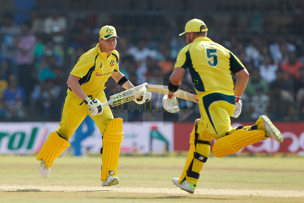 Steven Smith captain of Australia  and Aaron Finch of Australia running between the wickets during the 3rd One Day International between India and Australia held at the Holkar Stadium in Indore on the 24th  September 2017<br /> <br /> Photo by Deepak Malik / BCCI / SPORTZPICS