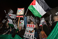 © licensed to London News Pictures. London, UK 15/11/2012. Protesters gather outside Israeli Embassy in London as the conflict in Gaza escalates. Photo credit: Tolga Akmen/LNP