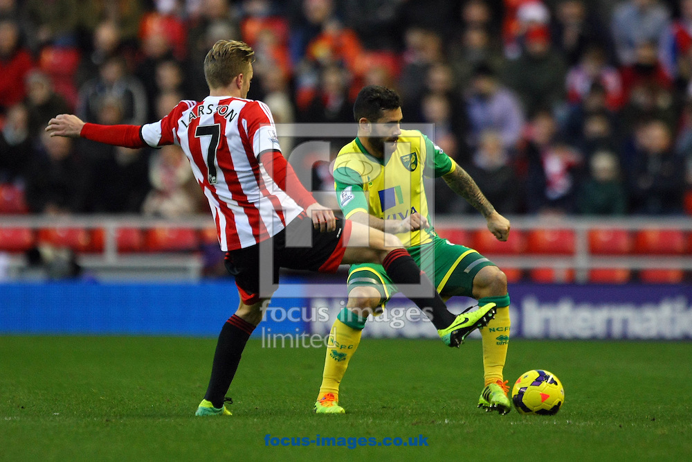Picture by Paul Chesterton/Focus Images Ltd +44 7904 640267<br /> 21/12/2013<br /> Bradley Johnson of Norwich and Sunderland's Sebastian Larsson in action during the Barclays Premier League match at the Stadium Of Light, Sunderland.