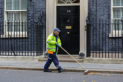 © Licensed to London News Pictures. 30/10/2019. London, UK. A Westminster street cleaner sweeps dry leaves outside No 10 Downing Street. On Tuesday 29 October 2019 MPs votes for a UK general election on 12 December 2019. Photo credit: Dinendra Haria/LNP