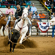 Steve Green throws his lasso during the steer roping event at the MLK Rodeo. Each year the National Western Stock Show hosts the rodeo inviting African American cowboys and community members to celebrate the legacy of Dr. King.
