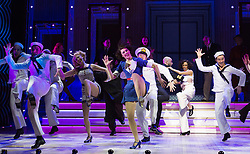 © Licensed to London News Pictures. 30/01/2015. London, England. Pictured: Cast performing. The Sheffield Crucible Theatre production of Cole Porter's classic musical comedy, Anything Goes, opens at the New Wimbledon Theatre, London, before embarking on a UK tour. Opening on 29 January and running to 7 February 2015, the musical is directed by Daniel Evans with Debbie Kurup as Reno and Matt Rawl as Billy, featuring Hugh Sachs, Simon Rouse and Jane Wymark. Photo credit: Bettina Strenske/LNP