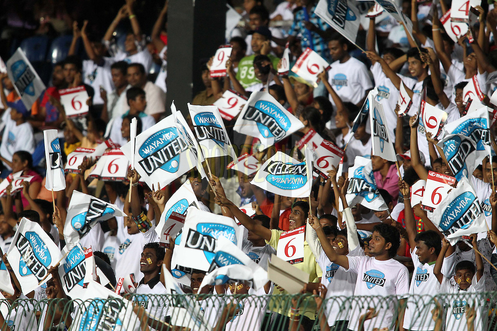 Fans celebrate a boundary during match 20 of the Sri Lankan Premier League between Ruhuna Royals and Wayamba United held at the Premadasa Stadium in Colombo, Sri Lanka on the 26th August 2012. .Photo by Shaun Roy/SPORTZPICS/SLPL