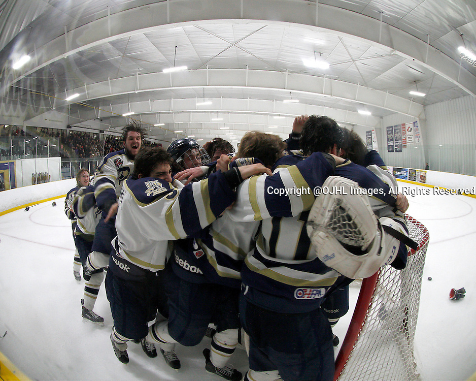 TORONTO, ON - Apr 22, 2015 : Ontario Junior Hockey League game action between the Kingston Voyageurs and the Toronto Patriots. Game seven of the Buckland Cup Championship Series. Toronto Patriots celebrate the series and Championship win.<br /> (Photo by Brian Watts / OJHL Images)