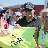 Driver A.J Foyt poses with fans during the 60th Annual NASCAR Daytona 500 auto race at Daytona International Speedway on Sunday, February 18, 2018 in Daytona Beach, Florida.  (Alex Menendez via AP)