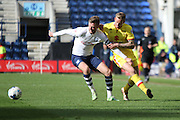 Preston North End Midfielder Paul Gallagher challenged  during the Sky Bet Championship match between Preston North End and Milton Keynes Dons at Deepdale, Preston, England on 16 April 2016. Photo by Pete Burns.