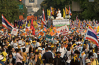"BANGKOK, THAILAND  -  March 14: Tens of tousands of demonstrators seeking the resignation of Prime Minister Thaksin Shinawatra marched to government house on March 14, 2006 in Bangkok, Thailand. Marching several kilometers from the Grand Palace to Government House the protesters surrounded Thaksin's office chanting ""Thaksin Get Out"", as the Prime Minister threatened a state of emergency if the demonstration turned violent.  (Photo by David Paul Morris)"