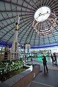 Entertainment center Duman. Family taking souvenir shots with a Sojus rocket model.