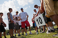 Eli Manning ,Quarterback for the New York Giants, winner of the 2012 NFL Superbowl, teaching at the Manning Passing Academy, a family owned football camp where teens  learn the fundamentals of football in Thibodaux, Louisiana.  Quarterback for the New York Giants, winner of the 2012 NFL Superbowl, teaching at the Manning Passing Academy, a family owned football camp where teens  learn the fundamentals of football in Thibodaux, Louisiana.