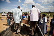 "Relatives and friends grieve for another victim of the Cholera outbreak in Zimbabwe...The funeral of Emmely Munyongo who died, aged 74 years, from Cholera at her home in the suburb of Glenora on the outskirts of Harare, Zimbabwe...The clinic is staffed by locals but assisted by MSF. As of 30 May 2009, there were 98 424 suspected cases, including 4 276 deaths reported by the Ministry of Health and Child Welfare (MoHCW) of Zimbabwe since August 2008. Fifty-five out of 62 districts in all 10 provinces were affected. in December 2008, Robert Mugabe declared that ""there is no cholera"" in Zimbabwe. Failing sanitation and lack of water supply were to blame, workers responsible claimed they had not been paid by the government for several months."