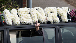 © Licensed to London News Pictures. 03/05/2018. Swanley, UK. A man gestures form a car window as The funeral procession of burglar Henry Vincent leaves Swanley to head to a service in St Mary Cray, Bromley, London. Henry Vincent, who is part of a traveller community in the south east London, died during an attempted burglary of the home of pensioner Richard Osborn-Brook in Hither Green. Photo credit: Ben Cawthra/LNP