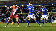 Lee Tomlin under pressure from Andrew Shinnie during the Sky Bet Championship match between Birmingham City and Middlesbrough at St Andrews, Birmingham, England on 18 February 2015. Photo by Simon Kimber.