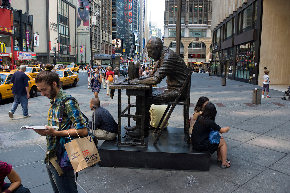 Fashion District / Garment District New York City..The Garment Worker (1984), is a life sized bronze sculpture by Judith Weller, depciting an immigrant man at a sewing machine..More than a million New Yorkers pass through Midtown every day, but few know that the neighborhood between 34th and 40th Streets, and Broadway and Ninth Avenue, houses one of the largest manufacturing clusters in New York City. In the Garment District, hundreds of small factories and suppliers work closely with designers to create the latest styles that make New York City a global fashion capital, and influence the clothes we wear every day..photo © Stefan Falke
