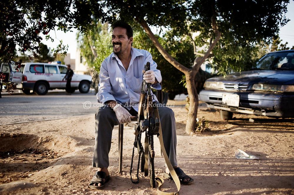 LIBYAN ARAB JAMAHIRIYA, Zintan : A Libyan man sit outside the  Zintan hospital in western Libya on July 13, 2011 after he was killed in an afternoon battle with forces loyal to Moamer Kadhafi in Gualish and Kikla, southwest of Tripoli.  ALESSIO ROMENZI