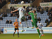Aaron Martin beats Ben Williams to the ball but his effort went just over the bar during the Sky Bet League 1 match between Coventry City and Bradford City at the Ricoh Arena, Coventry, England on 10 March 2015. Photo by Simon Kimber.