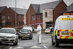 © Licensed to London News Pictures . 13/12/2015 . Bolton , UK . Forensic examiner at the scene . Greater Manchester Police report they are conducting a murder investigation after a man was stabbed on Brightmeadow Place in Breightmet in Bolton . Photo credit : Joel Goodman/LNP