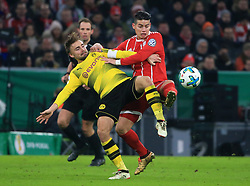 MUNICH, Dec. 21, 2017  Bayern Munich's James Rodriguez (front R) vies with Dortmund's Marcel Schmelzer (front L) during a German Cup 3rd round match between Bayern Munich and Borussia Dortmund, in Munich, Germany, on Dec. 20, 2017. Bayern Munich won 2-1 and advanced into quaterfinals. (Credit Image: © Philippe Ruiz/Xinhua via ZUMA Wire)