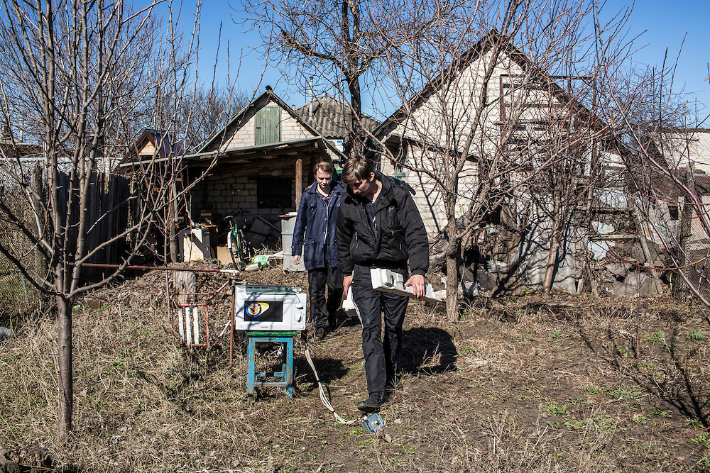 LUHANSK, UKRAINE - MARCH 16, 2015: Aleksandr Kryukov, left, and Pavel Pavlov prepare materials for scientific experiements involving microwaves in the yard of the house where Kryukov lives with his grandmother in Luhansk, Ukraine. The two have created a series of popular YouTube videos involving scientific experiements. CREDIT: Brendan Hoffman for The New York Times