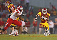 October 9 2010: Iowa State Cyclones running back Shontrelle Johnson (25) tries to avoid the defenders on a run during the first half of the NCAA football game between the Utah Utes and the Iowa State Cyclones at Jack Trice Stadium in Ames, Iowa on Saturday October 9, 2010. Utah defeated Iowa State 68-27.