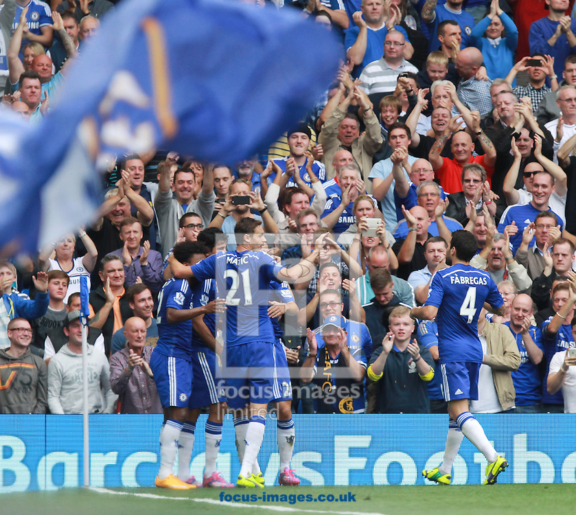 Diego Cost of Chelsea is mobbed by team-mates after scoring against Aston Villa during the Barclays Premier League match at Stamford Bridge, London<br /> Picture by John Rainford/Focus Images Ltd +44 7506 538356<br /> 27/09/2014