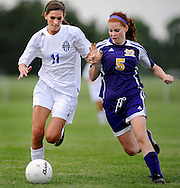 11 MAY 2012 -- ALTON, Ill. -- Alton Marquette High School soccer player Caroline Hoefert (11) battles Civic Memorial High School's Kourtney Pinkerton (5) during the Class 1A Regional Finals at Gordon Moore Park in Alton Friday, May 11, 2012. Photo © copyright 2012 Sid Hastings.