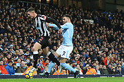Kyle Walker & Ciaran Clark fight for the ball during the Premier League match between Manchester City and Newcastle United at the Etihad Stadium, Manchester, England on 20 January 2018. Photo by George Franks.