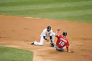 CHICAGO - JUNE 25:  Alexei Ramirez #10 of the Chicago White Sox cannot hang on to the ball as Danny Espinosa #18 of the Washington Nationals slides safely into second base with a stolen base in the second inning on June 25, 2011 at U.S. Cellular Field in Chicago, Illinois.  The White Sox defeated the Nationals 3-0.  (Photo by Ron Vesely)   Subject:  Alexei Ramirez;Danny Espinosa