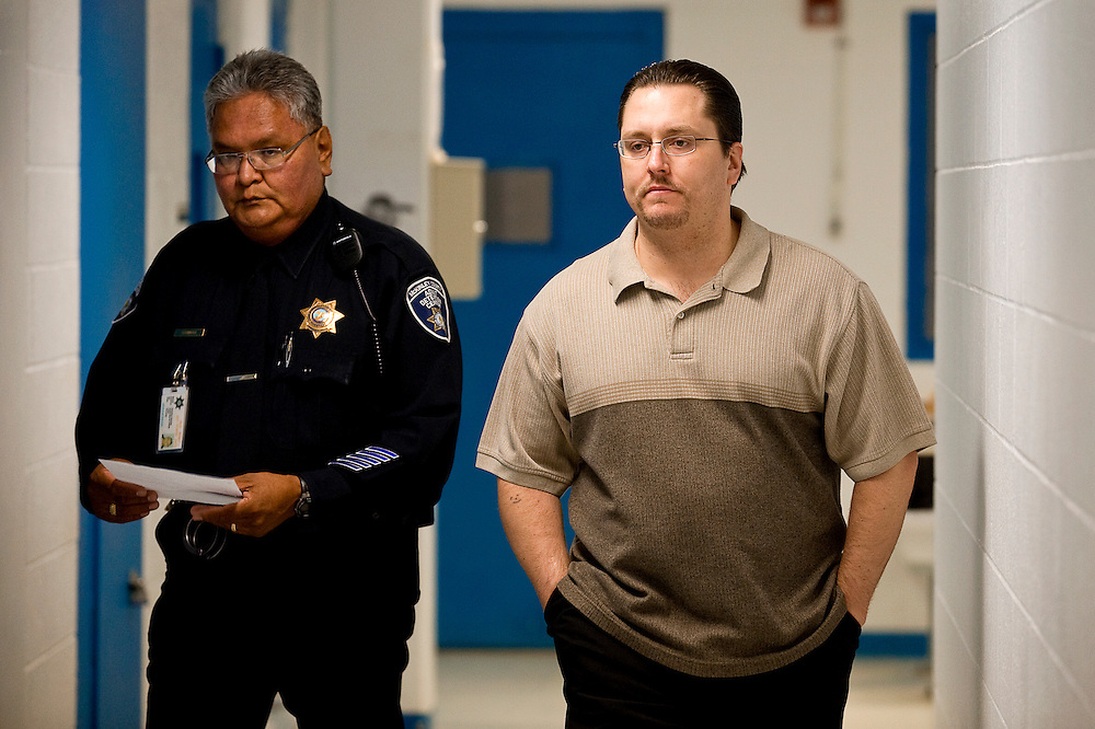 111809     Brian Leddy.Joseph Evans is escorted at the McKinley County Adult Detention Center on Tuesday morning on his way to his murder trial. Evans is accused of killing a Gallup teenager in 2005.