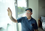Ken Keene Sr. shows how he waves to passers by through the window of his room as he speaks about living with early onset dementia Thursday, August 31, 2017 at the Delaware Valley Veterans Home in Philadelphia, Pennsylvania. (WILLIAM THOMAS CAIN / For The Philadelphia Inquirer)