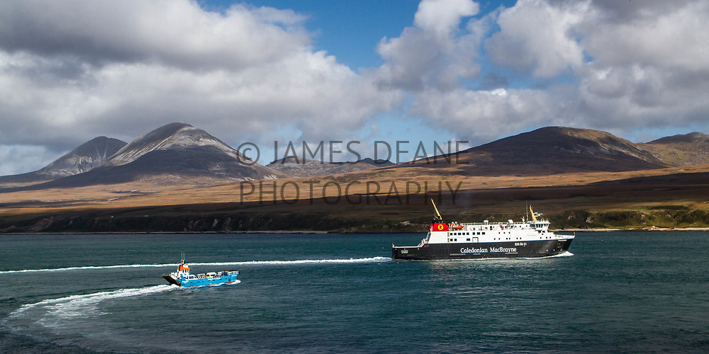 MV Finlaggan and the Jura ferry depart Port Askaig on the Sound of Islay
