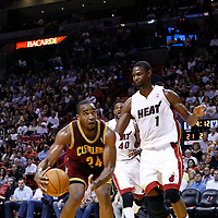 24 January 2012: Cleveland Cavaliers power forward Samardo Samuels (24) drives past Miami Heat power forward Chris Bosh (1) during the Miami Heat 92-85 victory over the Cleveland Cavaliers at the AmericanAirlines Arena, Miami, Florida, USA.